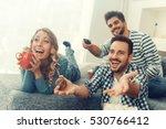 group of friends watching tv... | Shutterstock . vector #530766412