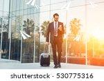elegant businessman checking e... | Shutterstock . vector #530775316