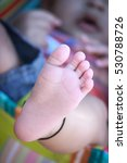 baby feet with five toes | Shutterstock . vector #530788726