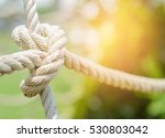 White Rope Tied In A Knot For...