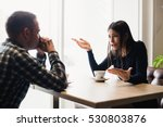 young couple arguing in a cafe. ... | Shutterstock . vector #530803876