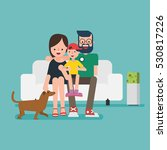 family sitting on sofa with dog | Shutterstock .eps vector #530817226
