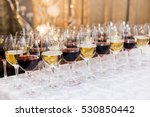 Many Glasses With White And Re...