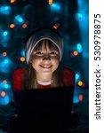 Young Smiling Girl In Santa\'s...