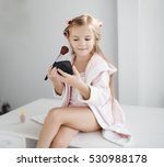 Cute Little Girl Making Up Wit...