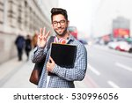 student man holding a book | Shutterstock . vector #530996056