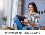 Young Woman Holding The Tablet...