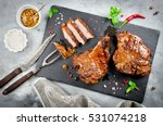 grilled steak on bone with... | Shutterstock . vector #531074218