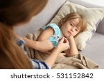 woman measuring temperature of... | Shutterstock . vector #531152842