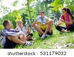 four people sitting on the... | Shutterstock . vector #531179032