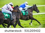 Stock photo jockey and horse taking the lead in a race 531205432