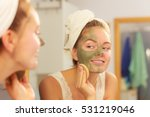 Woman Removing Facial Dried...