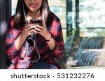 happy woman listen to music via ... | Shutterstock . vector #531232276