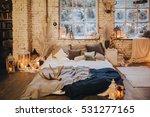 near snowy window is the bed... | Shutterstock . vector #531277165