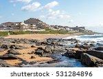 Beach Sand Rocks Against Blue...