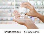 hand of doctor holding medicine ... | Shutterstock . vector #531298348