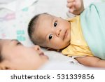 happy young mom and baby lying... | Shutterstock . vector #531339856