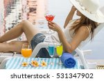 vacation. woman at swimming pool | Shutterstock . vector #531347902