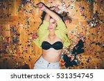girl laying on the floor full... | Shutterstock . vector #531354745