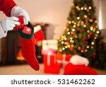 Close Up Of Santa Claus Puttin...