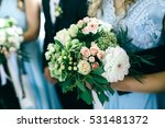 bridesmaid in blue dress holds... | Shutterstock . vector #531481372
