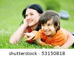 Mother and son in nature - stock photo