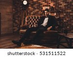 young man in suit resting on... | Shutterstock . vector #531511522