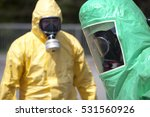 Small photo of Two men in protective gear cleaning up after chemical or radiation accident. The gear protects against contamination with radioactive particles, Alpha radiation and partially Beta radiation.