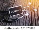 stethoscope on wood with... | Shutterstock . vector #531570082