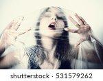 girl in cellophane film. | Shutterstock . vector #531579262