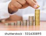 right hand putting add golden...   Shutterstock . vector #531630895