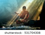 novice monk washes alms bowl in ... | Shutterstock . vector #531704308
