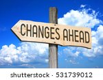 Small photo of Changes ahead - wooden signpost