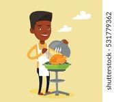 an african american man cooking ... | Shutterstock .eps vector #531779362