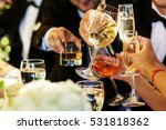 people clang glasses sitting at ... | Shutterstock . vector #531818362