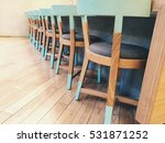 Row Of Wooden Chairs  With A...