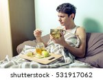 young man lies in bed sick with ...   Shutterstock . vector #531917062