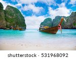 long boat and blue water at... | Shutterstock . vector #531968092