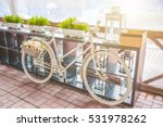 white vintage bicycle with... | Shutterstock . vector #531978262