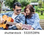 hipster man playing guitar for... | Shutterstock . vector #532052896