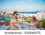 family having breakfast at... | Shutterstock . vector #532066375