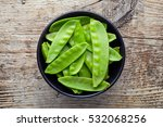 Bowl Of Snow Peas On Wooden...