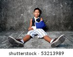 a young boy with blue sling on broken arm - stock photo
