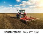 Farmer in tractor preparing...
