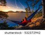 Woman Hiker Relaxing In Hammoc...