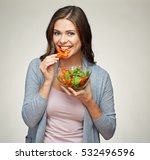 young smiling woman eating... | Shutterstock . vector #532496596