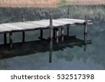 Small Pier On A Lake