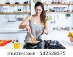 portrait of young woman frying... | Shutterstock . vector #532528375
