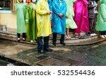 people in raincoats | Shutterstock . vector #532554436
