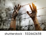 refugee men and fence | Shutterstock . vector #532662658